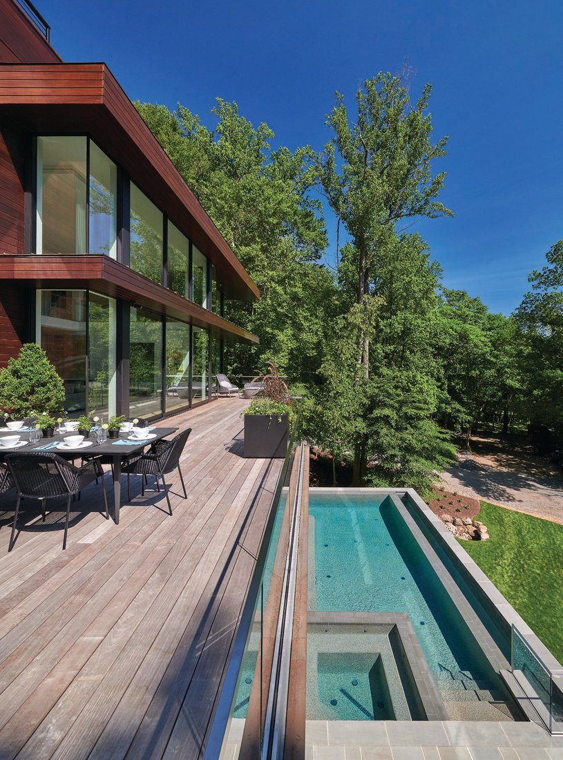 A gorgeous deck overlooks 3 acres that slope to the Potomac River. PHOTOGRAPHED BY ANICE HOACHLANDER